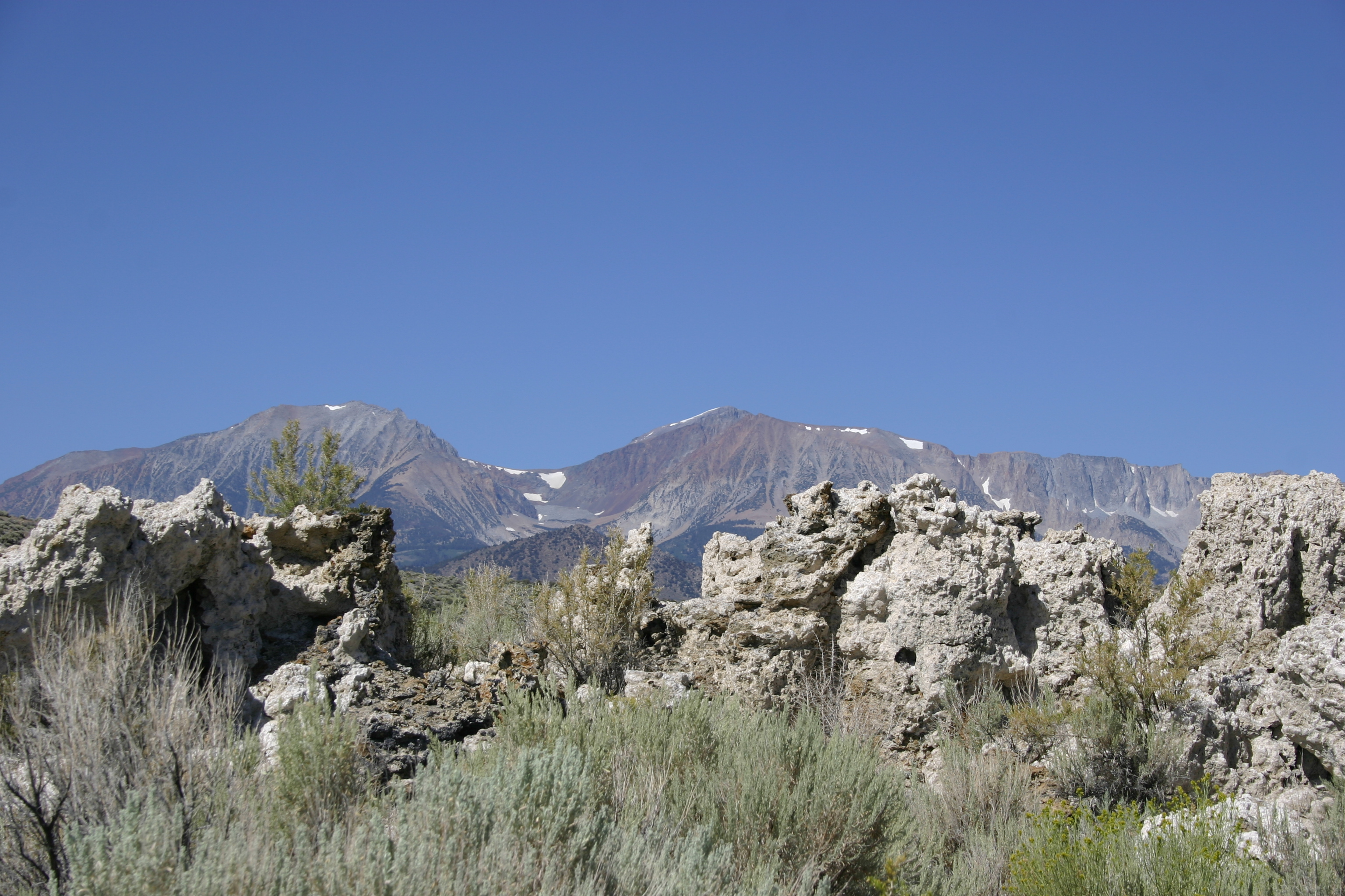 Tufa backed by snow-dotted mountains at Mono Lake.