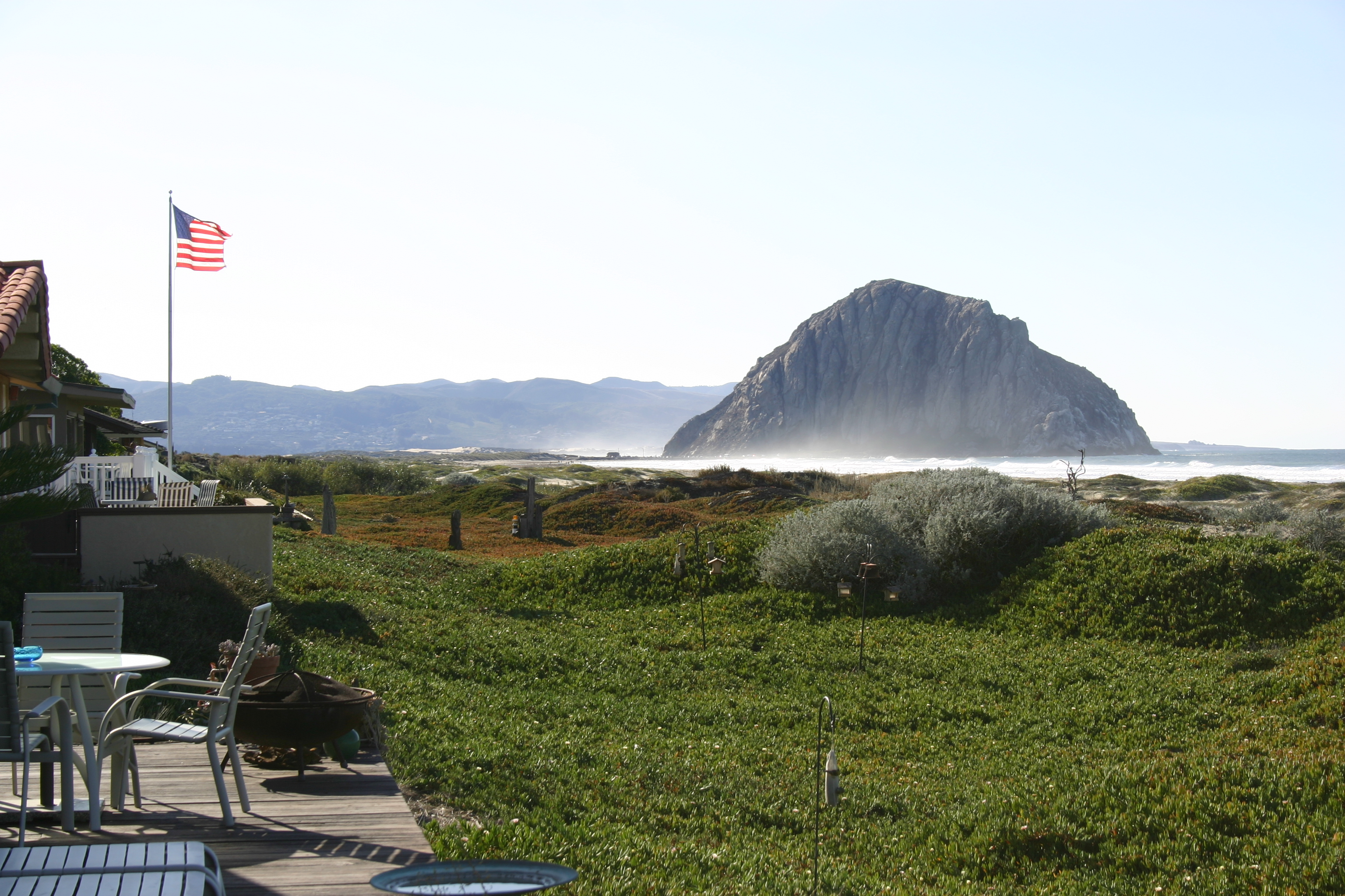 An American flag flies proudly over a patio near Morro Rock.