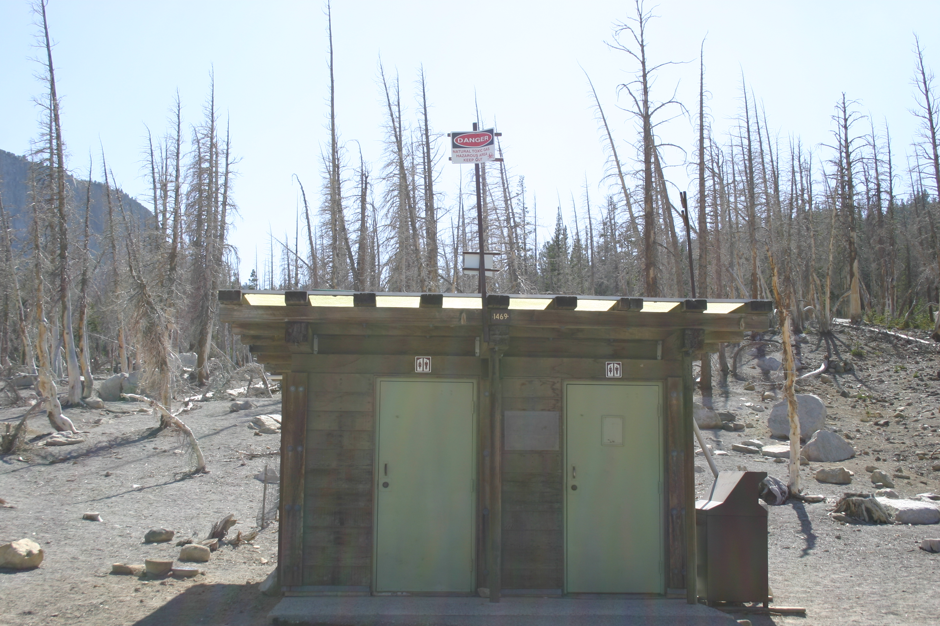 "Sign above a restroom: ""DANGER. Natural toxic gas. Hazardous area. Keep out."" I found this too funny to pass up. However, the reasons for the sign are not so funny.