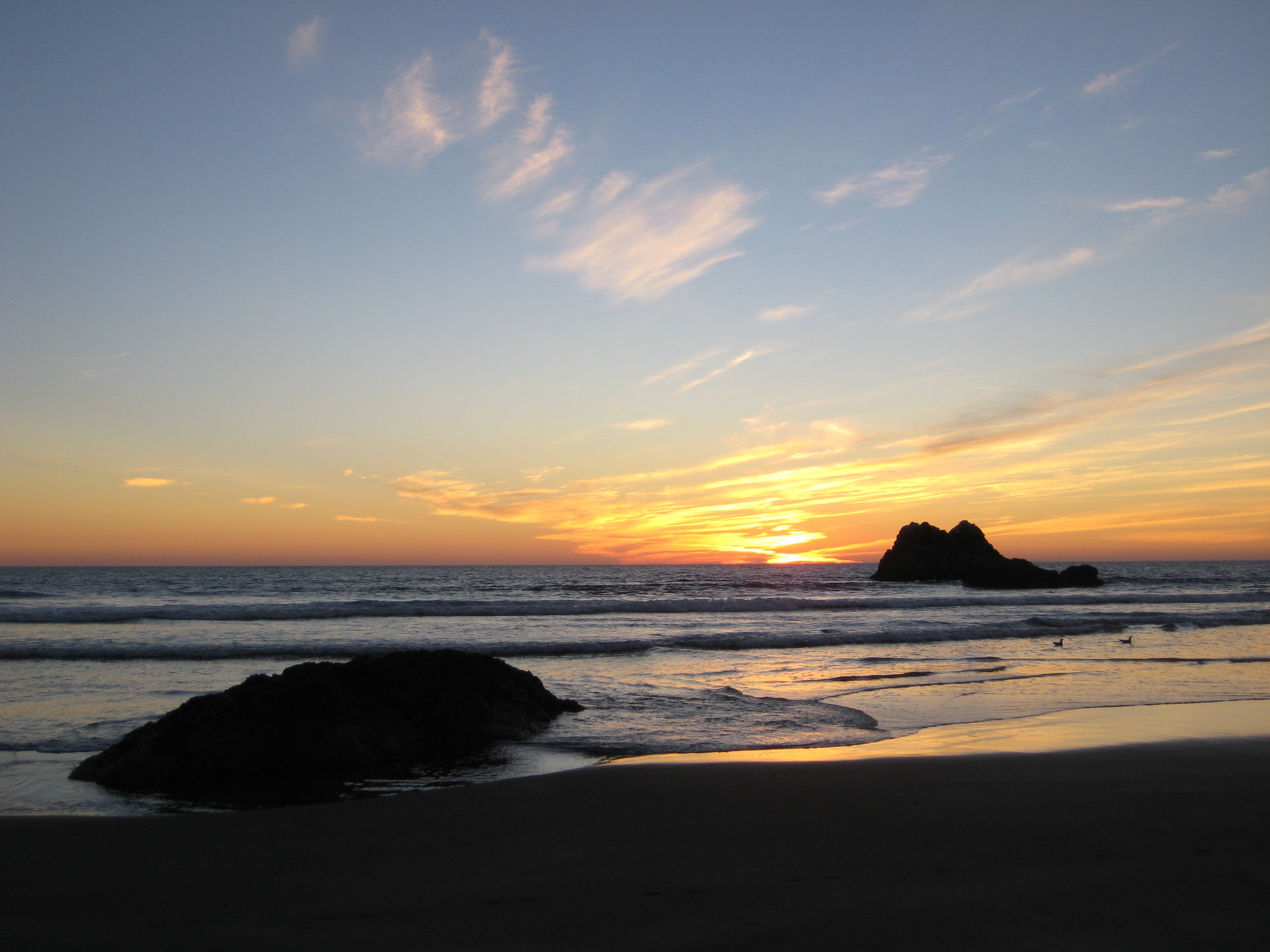 Orange sunset at the beach in Morro Bay.
