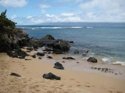 Black rocks on Kapalua Beach on Maui.