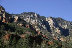 Red and gray rock cliffs and towers in Sedona.