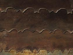 Overlapping rusty saw blades.