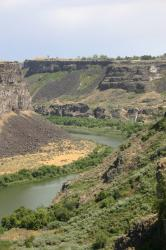 Snake River Canyon in Twin Falls, Idaho. You can see a waterfall in the distance on the right.