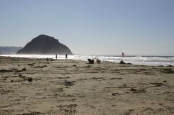 An American flag flies on the beach near Morro Rock.